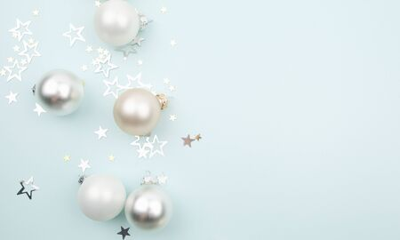 Christmas composition with christmas balls and stars on light blue background. Christmas, winter, new year concept. Flat lay, top view, copy space Zdjęcie Seryjne
