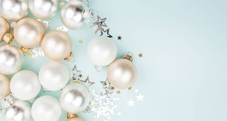 Christmas composition. Colorful decorations with christmas balls on light blue background. Christmas, winter, new year concept. Flat lay, top view, copy space
