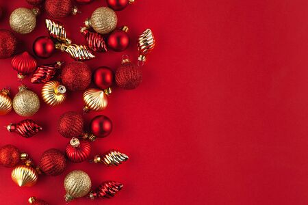 Christmas balls on red background top view decorations, Flat lay, copy space