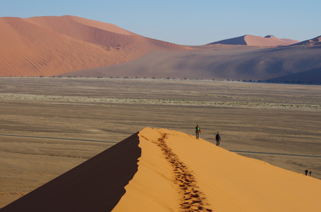 namibia: Hikers on the dunes, Namibia Stock Photo