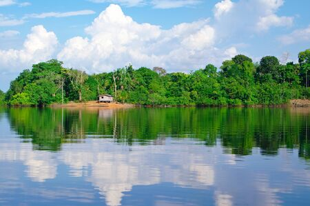 tilt: Tilt house on the Amazon river Stock Photo