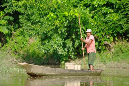 br: MANAUS, BR, CIRCA AUGUST 2011 - Man on a canoe on the Amazon river, circa August 2012 at Manaus, BR. Editorial