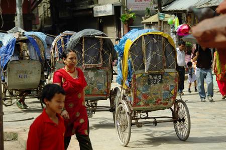 carriageway: KATHMANDU,NP CIRCA AUGUST 2012 - Rickshaws, typical transportation in Nepal circa August 2012 in Kathmandu.