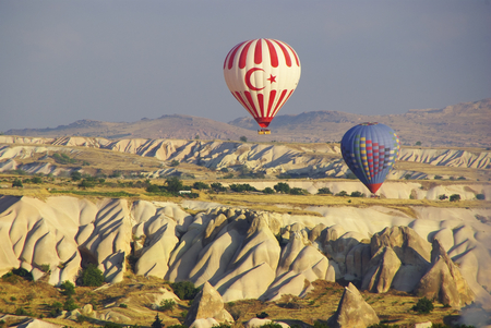 peculiar: Hot air balloons flying over the peculiar geological formations of Cappadocia Editorial