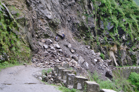 interrupt: A Landslide interrupt the road in Kali Gandaki valley in Nepal, near Tatopani, in the Monsoon rainy season Stock Photo