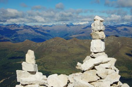 Piled stones on the summit of Rotwand, Italian dolomites