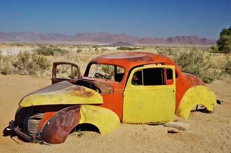 abandoned car: Abandoned car in the Namib desert near Solitaire Stock Photo