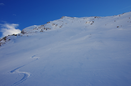 ski traces: Single skier track on a long untouched slope