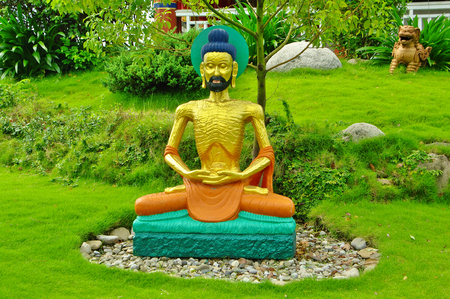 illustrating: Buddhist temples in Lumbini, with statues illustrating the life of Siddharta