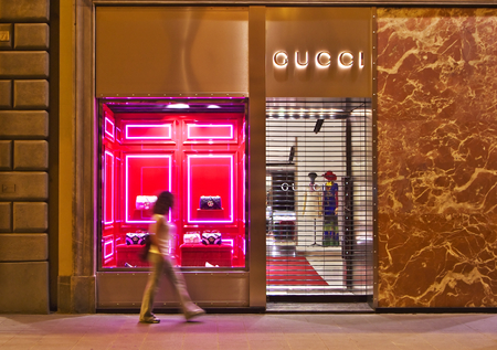 FLORENCE, 20 AUGUST 2016 - Girl walks in front of Gucci shop in the historic center of Florence, on 20 August 2016.