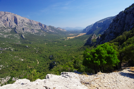 View of Lanaitho valley in Sardinia, near the ancient village of Tiscali Фото со стока