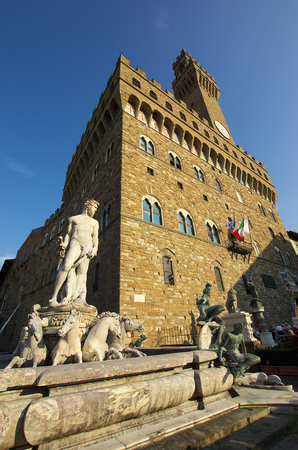 FLORENCE,IT - SEPTEMBER,9 2016 - Fountain of Neptune and Palazzo della Signoria in Florence