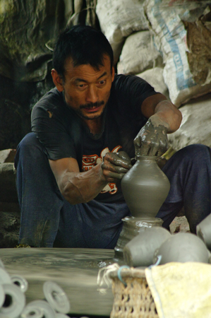 modelled: BHAKTAPUR,NP - CIRCA AUGUST, 2012 - Nepalese artisan makes a clay pot modelled with his hands.
