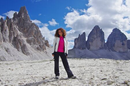 Young attractive female hiker in front of Tre Cime di Lavaredo, Dolomites