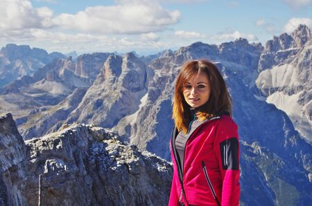 Young attractive female hiker on top of Croda Rossa, Rotwand