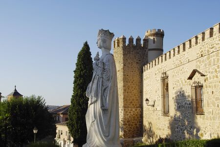 queen isabella: Statue of Queen Isabella in Toledo, with castle in background. Editorial