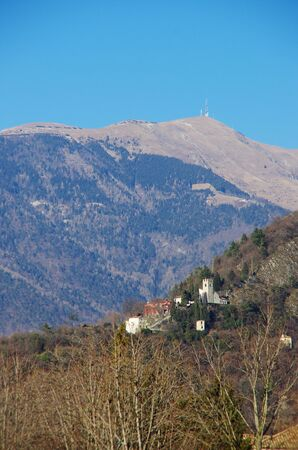Santa Augustas castle towering over the old district of Serravalle, Vittorio Veneto. In the background the highest mountain of the Trevisos province, Col Visentin. Editorial
