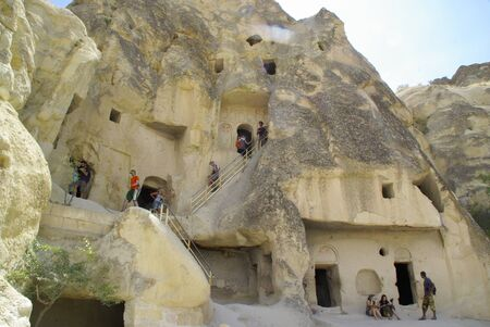 tr: GOREME, TR - CIRCA AUGUST, 2009 -The Fairy chimneys, typical geologic formations of Cappadocia, excavated by humans to be used as houses and churches.