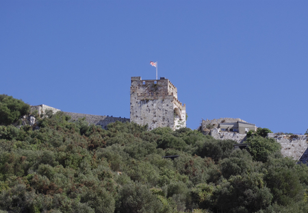 The Union Jack on a tower on the Gibraltar peninsula.