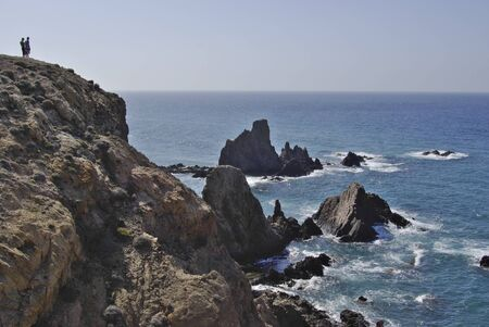 The wild coastline of Cabo the Gata,Spain. Cabo the Gata is a natural reserve and a favourite resort for naturists. Stock Photo