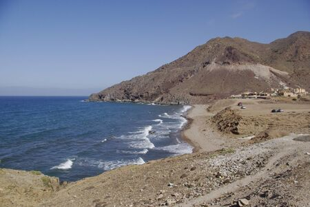 nudism: The wild coastline of Cabo the Gata,Spain. Cabo the Gata is a natural reserve and a favourite resort for naturists. Stock Photo
