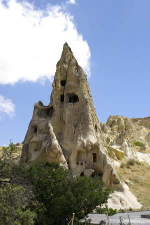 GOREME, TR - CIRCA AUGUST, 2009 - The Fairy chimneys, typical geologic formations of Cappadocia, excavated by humans to be used as houses and churches. Editorial