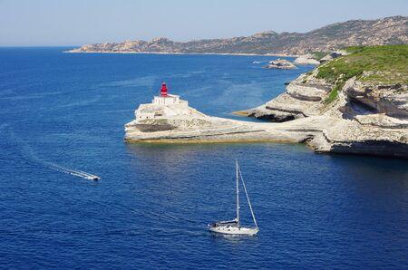 Bonifacio, FR - JUNE 21, 2017 - The gulf of Bonifacio offers a natural harbour for the boats. Bonifacio citadel is built on high cliffs above the Mediterranean sea.