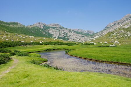 On the wet plateau I Pozzi, covered with small lakes and green fields. Stock Photo