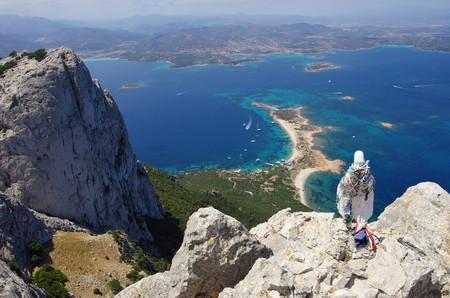 The statue of the Virgin on the summit of Tavolara, overlooking the sea. Stock Photo