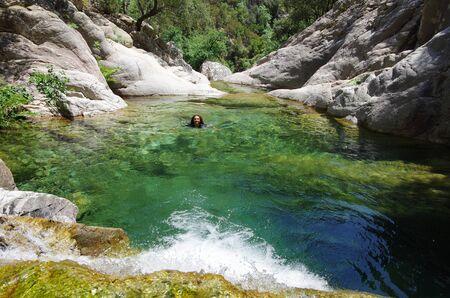 The idillyc waterfalls and pools of Purcaraccia canyon, among the Aiguilles de Bavella range. Stock Photo