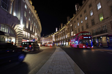 regent: LONDON,UK - CIRCA OCT 2017 - Tourists and the typical red bus on Regents street, near Piccadilly Circus. Editorial