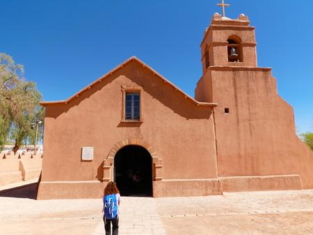 Church of San Pedro de Atacama in the north of Chile. Young female tourist