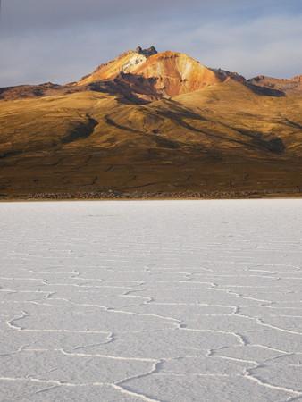 The incredible salt flat of Salar de Uyuni, on the andean altiplano of Bolivia, South America.Volcano Tunupa in the distance.