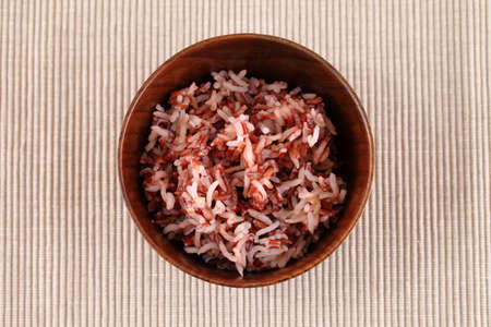 Red rice in a small ceramic dish photo