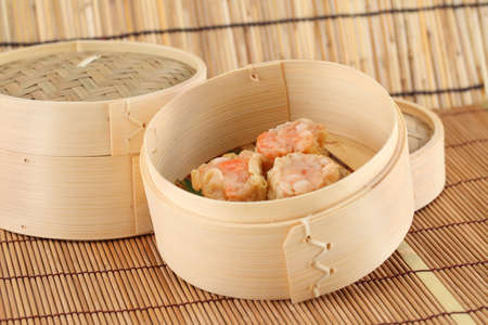 dim sum: Dim Sum in Bamboo Steamed Bowl Stock Photo