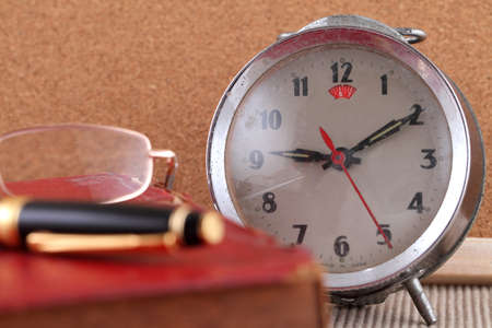 Old clock with Eye glass and pen photo