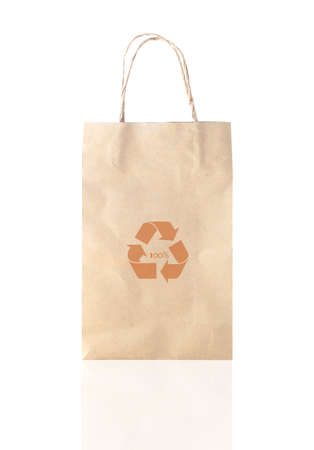 Recycle logo on paper bag shopping on white background photo