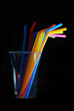 refraction of light: Drinking straw refracted ,black backgroun Stock Photo