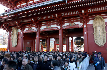 TOKYO, JAPAN - JANUARY 1  People drifted through the streets of Asakusa Temple Nakamise to seek blessings in the New Year in January 1 2009 in Tokyo, Japan