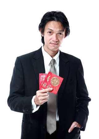 Businessman show cash gift pocket money for chinese new year ,  isolated on white  photo
