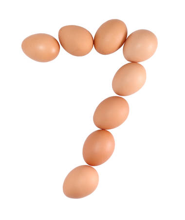 Number seven made of Eggs  Isolated on white  photo