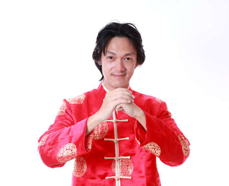 Happy Chinese new year.Young Asian man with gesture of congratulation 版權商用圖片 - 24458535