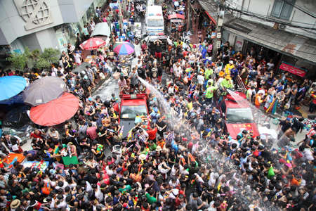 silom: BANGKOK - APRIL 13  Stream of water over the crowd of people during celebrating the traditional Songkran New Year Festival, April 13, 2012, Silom road, Bangkok, Thailand  Editorial
