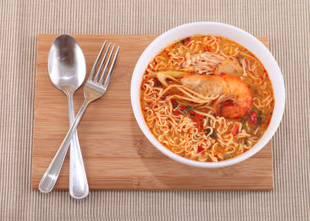 Tom Yam Koong soup with noodles photo