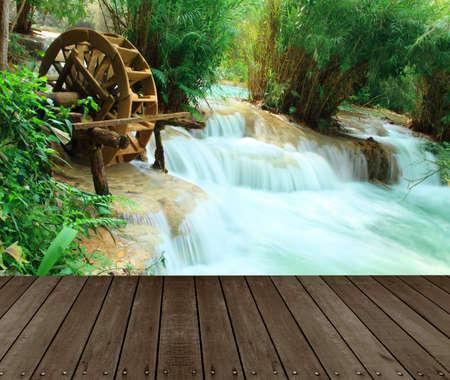 Tat Guangxi Waterfall, Luang Prabang.Wood floor perspective and natural mountain waterfall.