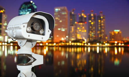 CCTV with Blurring City in night background. photo