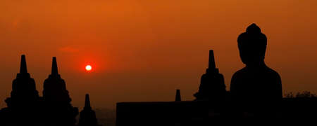 Morning silhouette of Buddha image on Borobudur temple,Yogyakarta. Java, Indonesia. photo