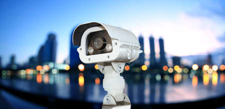 CCTV with Blurring City in night background. Banque d'images