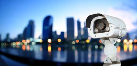 CCTV with Blurring City in night background. 版權商用圖片