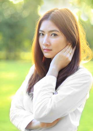 Beauty Romantic Girl Outdoors. Beautiful Teenage Model girl in White Dress on the Field in Sun Light. Blowing Long Hair. Autumn. Glow Sun, Sunshine. Backlit. Warm colors